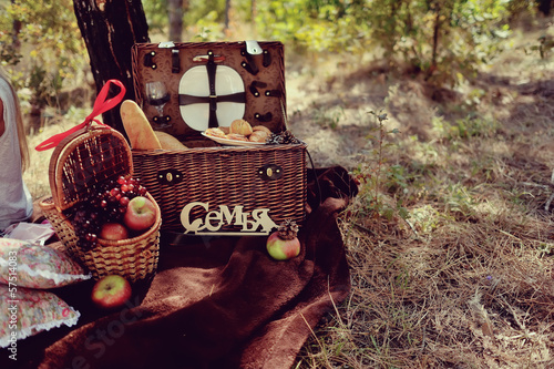 autumn still life in the woods picnic basket with fruit and brea