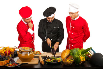 Chef teacher with students in kitchen
