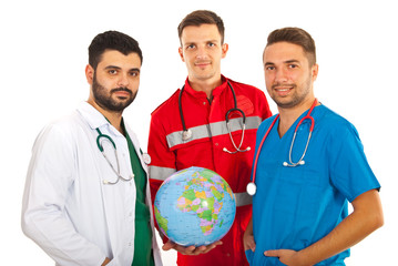 Different doctors holding globe