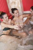 Young women relaxing in the hot tub