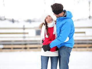 Ice skating romantic couple on date iceskating