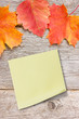 Sticky note on the board with autumnal leaves