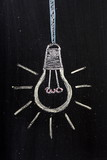 Light Bulb on a used Blackboard