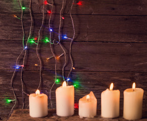 Christmas lights on a wooden background with copy space