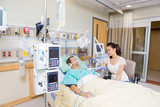 Worried Woman Looking At Critical Patient