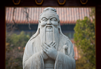 statue of Confucius in Temple of Confucius in Beijing, China