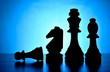 Silhouetted chess pieces