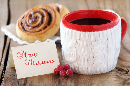 christmas coffee with cinnamon rolls and greeting card