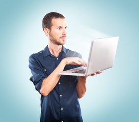 Young man holding a laptop
