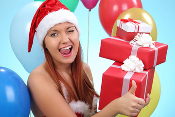 Surprised and happy girl with gifts