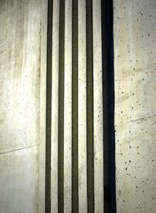 Background vertical texture from light rough concrete bands