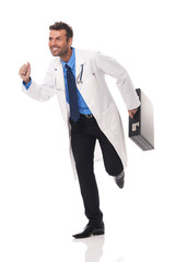 Smiling doctor running to his patients