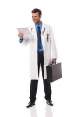 Smiling doctor checking something on digital tablet
