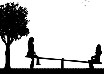 Girls in the park on a seesaw silhouette