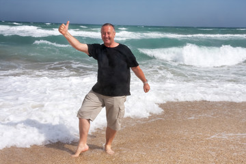 Man is happy at sea