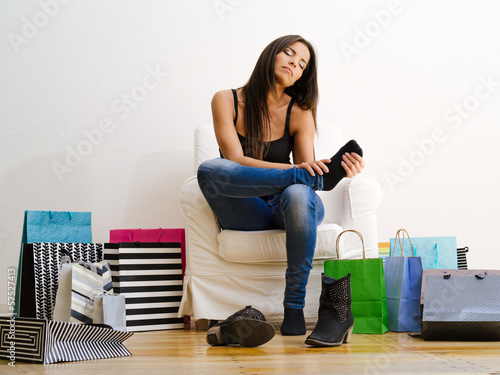 Shopaholic rubbing her tired feet