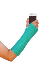 green cast on hand and arm, holding mobile phone.