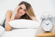 Suffering young woman having headache lying on her bed