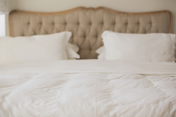 Empty bed with white duvet cover