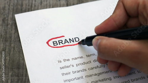 Circling brand with a red marker