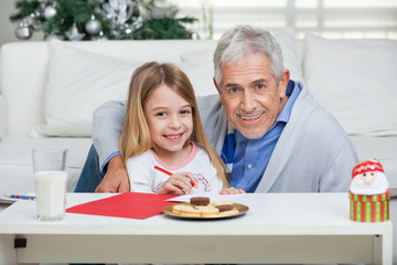 Happy Grandfather And Girl With Cardpaper