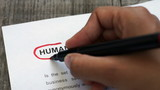 Circling Human Resources with a red marker