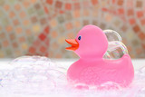 Pink rubber duck in bath foam
