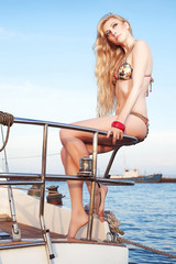 Portrait of a gorgeous long-haired blonde in stylish swimsuit