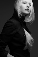 Portrait of a beautiful fashionable model in black coat