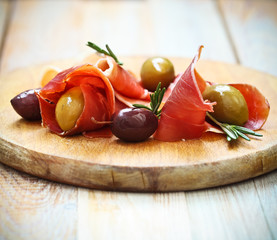 Prosciutto with olives and rosemary