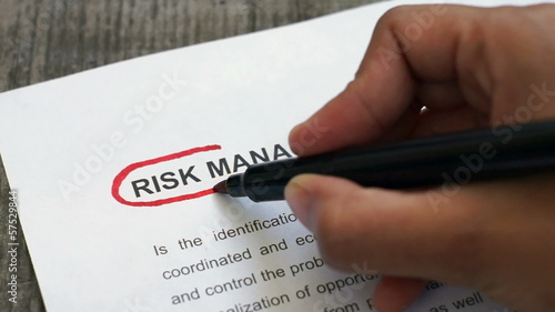 Circling Risk Management with a red marker
