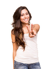 Young woman showing peace / victory sign