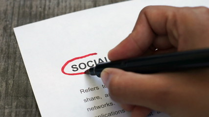 Circling Social Media with a red marker