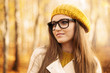Beautiful woman wearing glasses during the autumn