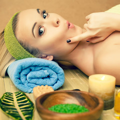 Portrait of a funny and beautiful young woman in spa salon