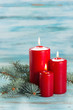 Christmas candles with evergreen decorations