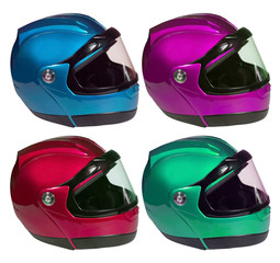 Motorcycle helmets on a white background in different colors. Co