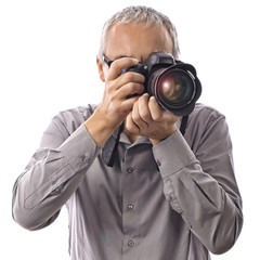 Professional photographer taking pictures with camera on white
