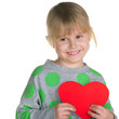 Little girl holds a red heart