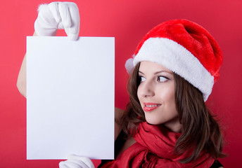 Christmas girl in santa hat holding banner. Isolated.