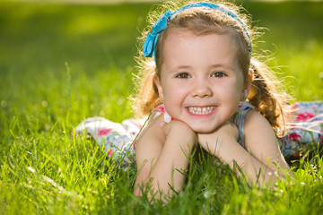 Laughing little girl on the grass