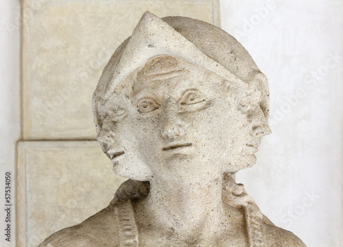 Close-up on a Statue's Three-Faced Head