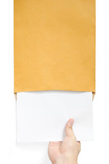 Hand pulling paper from envelope