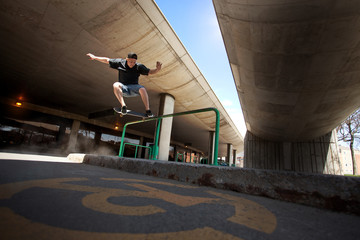 Skateboarder doing a Crooked Grind trick on a Rail