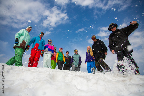 Group of people are jumping in snowy mountains