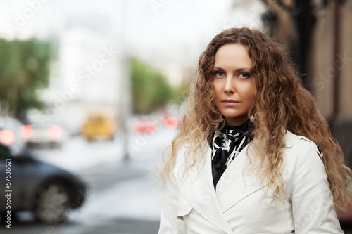 Beautiful woman in white on the city street
