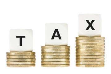 Word TAX on Gold Coin Stacks Isolated with White Background