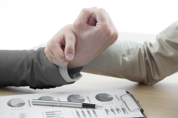 female and male hands pointing at business