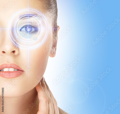 Portrait of young woman on an eye surgery on blue