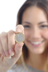 Close up of a woman hand showing an euro coin